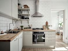 Contemporary Meets Cosy In a Swedish Apartment - Contemporary Meets Cosy In a Swedish kitchen with grey-beige cabinets and white subway tiles. Swedish Kitchen, Scandinavian Kitchen, Swedish Style, Swedish House, Kitchen Dining, Kitchen Decor, Kitchen Cabinets, Beige Kitchen, Kitchens