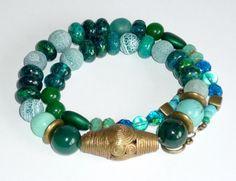 Ein Schatz der Südsee - ein Facettenreich von türkis, grün bis smaragd - edle Steine und feines Glas gewürzt mit Bronze.    Aus meiner Sammlung alt...
