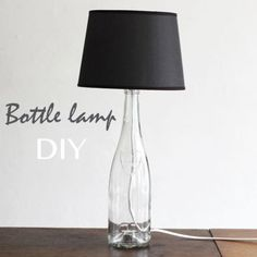 Make a lamp from an old liquor bottle and lamp kit in one afternoon. Free tutorial with pictures on how to make a bottle lamp in under 120 minutes by decorating with screwdriver, bottle, and lamp. in the Home + DIY section . Diy Bottle Lamp, Bottle Art, Blue Bottle, Oil Bottle, Wine Craft, Wine Bottle Crafts, Garrafa Diy, Diy Luminaire, Diy Upcycling