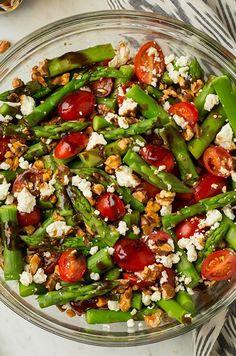 Ingredients:\n Vinaigrette\n 6 Tbsp balsamic vinegar\n 1/4 cup olive oil\n 2 tsp dijon mustard\n 2 tsp honey\n 1 clove garlic, minced\n Salt and freshly ground black pepper\n\n  Salad\n 2 lbs fresh asparagus (preferably medium thickness), tough ends trimmed, remaining diced into 2-inch pieces\n 1 (10.5 oz) pkg. grape tomatoes, halved\n 2/3 cup chopped walnuts, toasted\n 4 oz feta cheese, crumbled (scant 1 cup)