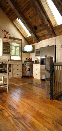 FARMHOUSE – INTERIOR – early american decor inside this vintage farmhouse seems perfect in this kitchen with soaring ceilings and a perfect wood floor.