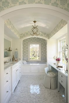 such a pretty bathroom, the arched ceiling, wallpaper, lighting fixture....love the vanity & windows...