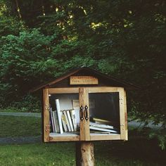 """codiannthomsen: """" I just found the first free library that I've ever seen in person on a hike we're all taking to the ocean. This has got to be the most charming thing I've ever seen. """""""