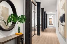 Black Steel Columns With Large Rivets Are A Reminder Of This New York Apartment's Location In The SoHo Cast Iron Historic District Steel Columns, Steel Beams, Living Area, Living Spaces, Marble Island, New York Apartments, Large Artwork, Built In Desk, Large Bathrooms