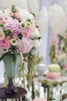 Large backdrop arrangements with pink hydrangeas and dahlias, green centered ranunculus, succulents and roses.  Wow!