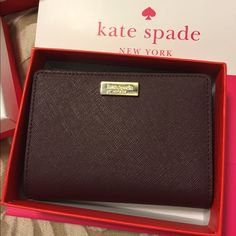 Kate Spade Cara wallet - Mulledwine NWT. Cara Newberry Lane wallet. Lots of pockets and zip up change pouch. 100% authentic Kate Spade. Comes with store box, gift bag and all tags.  Nice smaller size for any sized purse. Retails $115 plus tax. Price is FIRM and at LOWEST. Dark blue -- NOT black. :) New in box and never used.  ❌ no trades.  less on Ⓜ️ kate spade Bags Wallets