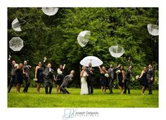 Rainy weddings don't have to be a disappointment. Here is a fun bridal party photo in the rain! #njweddings. More fun as www.aphotographerinnewjersey.com