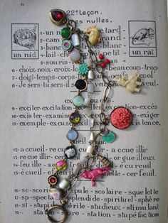 Foxy 3 Strand Vintage Repurposed Charm Bracelet  I'm a hoarder. There, I said it. I've got drawers and drawers filled with tiny things: beads, charms, glass cabochons, etc., etc. etc. I found this vintage plated disc chain and rifled through my stash to find things to glue to it. Turns out, that was not a problem! So, I made a couple 3 strand bracelets...