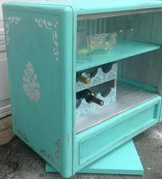 Liquor cabinet in repurposed from old TV console with lighting wine rack and swivel bottom !!