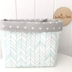 Mint featherland with grey triangles fabric basket