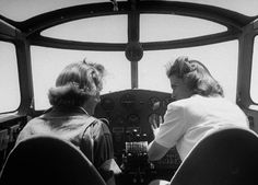 Flying instructor Helen Duffy (R) is going over the cockpit procedure with one of her advance pilot trainees, from the Women's Flying Training Detachment, July 1943. #vintage #WW2 #women