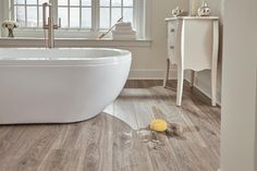 Exclusive to Floor & Decor, AquaGuard ® is a water-resistant laminate that looks and feels like authentic hardwood! There's now a laminate option for every room in the house — including kitchens, mudrooms, and even full bathrooms. Aquaguard Flooring, Types Of Flooring, Bedroom Flooring, Flooring Options, Floors, Flooring Ideas, Luxury Vinyl Tile, Luxury Vinyl Plank, Floor Decor And More
