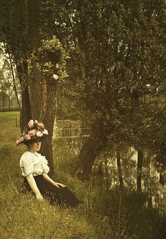 Woman with flowerhat, 1910. Autochrome by Charles Corbet  This makes me think of Anne of Green Gables, when she decorates her own hat with roses and buttercups.  It can't have been more over the top than this one.