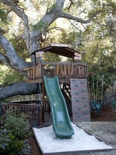 Treehouse with slide and small climbing wall. Like the large 'deck,' only partially covered....