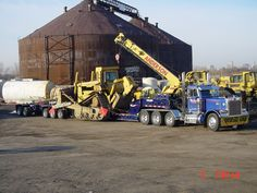 Peterbilt TriAxle and a Trail King beam trailer and a 2 axle stinger on the rear....