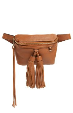 Pack away only the essentials in this chic belt bag from Rebecca Minkoff. It's crafted with smooth leather and accented with fun fringe tassels.