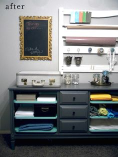 This is a great little sewing desk, complete with a repurposed headboard as a hanging rack for fabrics.