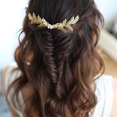 Boho wedding hair half up, half down with a waterfall twist, loose waves and fishtail braid. Hair accessory by Donna Crain.