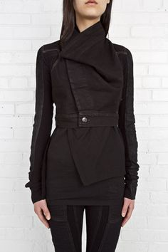 This supertight and short black denim jacket will fit you like a glove. By Rick Owens