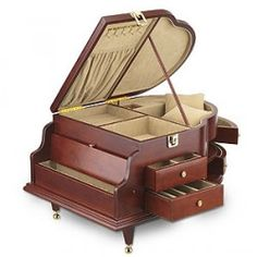 This wooden Jewellery Box is made in the shape of a piano. It has multiple compartments, fully lined. With a beautiful wooden finish, this Jewellery Box will look lovely in the bedroom.