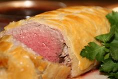 Prosciutto & Mascarpone Cheese Beef Wellington w/Chocolate Port Wine Reduction Sauce http://cookingwithmelody.com/all-recipes/main-courses/meat-main-courses/prosciutto-mascarpone-cheese-beef-wellington-with-port-wine-chocolate-reduction-sauce/