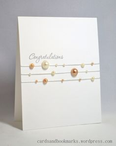 Simple text (celebrate, happy) and decorate with delicate string or ribbon and add texture like buttons or half-pearls.
