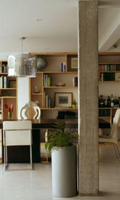Eclectic Apartment. Bare Concrete, Concrete Floors, Wooden Panels.