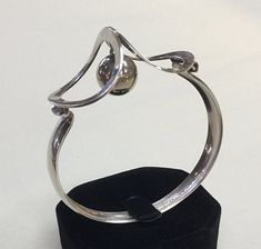Erik Granit (FI), modernist sterling silver vintage bracelet with a dangling silver sphere detail, 1973. more by Erik Granit  subscribe newsletter   Don't miss a post.