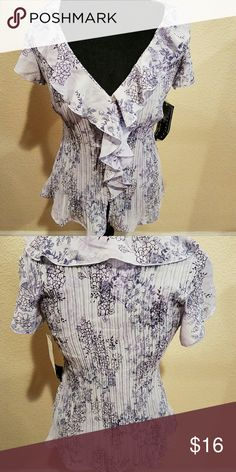 Separated by NY Design Blouse Lavender blouse with dark purple design made of 100% poly.  Crepe fabric design with ruffle at neckline and down the front.  Button up in front. WC0036 Tops Blouses