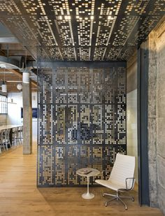Giant Pixel / Studio O+A (blackened steel canopy perforated with a computer code pattern)