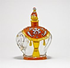1921 Baccarat, Lubin Kismet perfume bottle and stopper, clear crystal, rare red enamel decoration, gilt label and detail, numbered. 4 1/4 in.