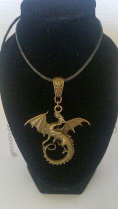 Antique bronze dragon on cord. AUS $ 9.00