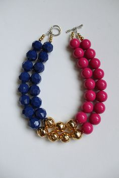 Love the different bead shapes. The Mackenzie - color block navy, dark pink and gold statement necklace. $95.00, via Etsy.