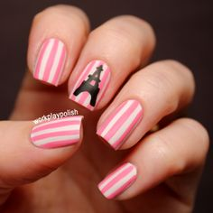 Use caviar on nail with Eiffel tower. Paint white then pink stripes