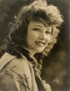 Signed photo of Silent Film actress Betty Compson born 19 March 1897, passing away 18 April 1974. Compson began acting in 1915. In 1923 she stared in a number of films directed by Graham Cutts. Her first film for Cutts was Woman to Woman (1923). The film was co-written by Cutts and Alfred Hitchcock who also stood in as assistant director. Compson would star in a number of notable films such as The Docks of New York (1928) directed by Josef von Sternberg before entering the sound era.