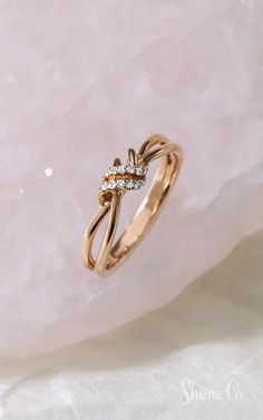 Give the gift of diamonds this Valentine's Day. This chic ring creates a beautiful knot design with 21 round diamonds forming an interlocking loop. The design measures at the widest point and is crafted from quality rose gold. Pear Shaped Engagement Rings, Engagement Ring Shapes, Vintage Engagement Rings, Gold Ring Designs, Gold Jewelry Simple, Diamond Wedding Rings, Diamond Rings, Unique Rings, Diamond Jewelry