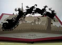 The Night Before Christmas pop-up book . . . A classic story with beautiful cut-paper artwork.  Buy at Target.com for $11 and YES, it's available in English.  (photo found at Good Books For Young Souls)
