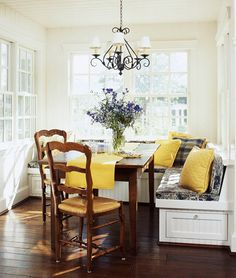 traditional home banquette. This is exactly what I want to do in my dining room, but with a Tuscan theme of oranges, yellows, and cremes. <3