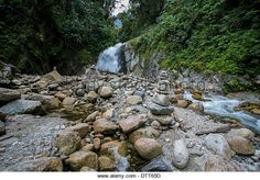 l7.alamy.com zooms b92f684615a3476392fb4efe7dd1a1de inka-trail-inka-path-forest-rocks-piled-up-by-the-river-and-waterfall-dtt65d.jpg