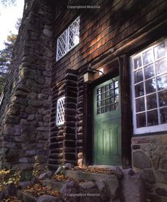 Gustav Stickley's house in the craftsman style using shingle siding, cossed pane windows, and heavy stone chimney. Gorgeous.