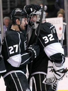 LOS ANGELES, CA - APRIL 15: Goalie Jonathan Quick #32 of the Los Angeles Kings is congratulated by Alec Martinez #27 after Quick's shutout against the Vancouver Canucks in Game Three of the Western Conference Quarterfinals during the 2012 NHL Stanley Cup Playoffs at Staples Center on April 15, 2012 in Los Angeles, California. The Kings won 1-0 to take a 3 games to 0 lead in the series. (Photo by Stephen Dunn/Getty Images)