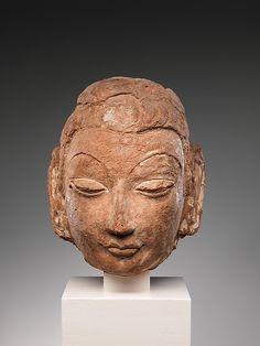 6-7th C. Head of Buddha  from Rawak Buddhist Stupa, Khotan Kingdom (ancient Afghanisthan) unfired red clay.