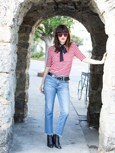 """For spring, considerswapping your basic white tee for a Breton-striped iteration à la Jane Birkin. Ash explains that fit is key here: """"[Your] striped shirt [should] fit like a glove, and..."""