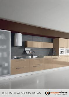 Light brown wood cabinets with a glass door pantry and stainless stell range hood.