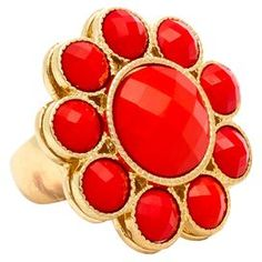 """Stretch ring in gold with a ring of faceted coral stones around a central, matching stone.  Product: RingConstruction Material: Metal and resinColor: CoralFeatures: Stretches to fit any fingerDimensions: 1.5"""" DiameterCleaning and Care: Do not get wet or use jewelry cleaner on costume jewelry"""