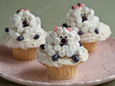 Little Lamb Cupcakes : Transform cupcakes into characters with our instructions to make tiny lambs from mini-marshmallows. Each little critter has jellybean ears and feet, a jujube nose and candy eyes.
