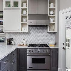 White Upper Cabinets with Distressed Gray Lower Cabinets