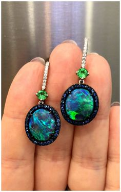 A stunning pair of opal, sapphire, and diamond earrings by Omi Prive. Spotted at the 2018 AGTA GemFair.
