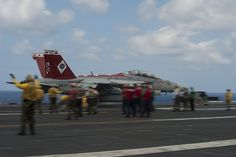 """PHILIPPINE SEA (Sept. 26, 2013) An F/A-18 Super Hornet from the """"Diamondbacks"""" of Strike Fighter Squadron (VFA) 102 launches off the flight deck of the U.S. Navy's forward-deployed aircraft carrier USS George Washington (CVN 73). (U.S. Navy photo by Mass Communication Specialist Liam Kennedy/RELEASED)"""