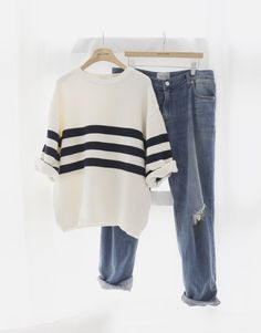 Perfect outfit formula: a striped sweater and boyfriend jeans.